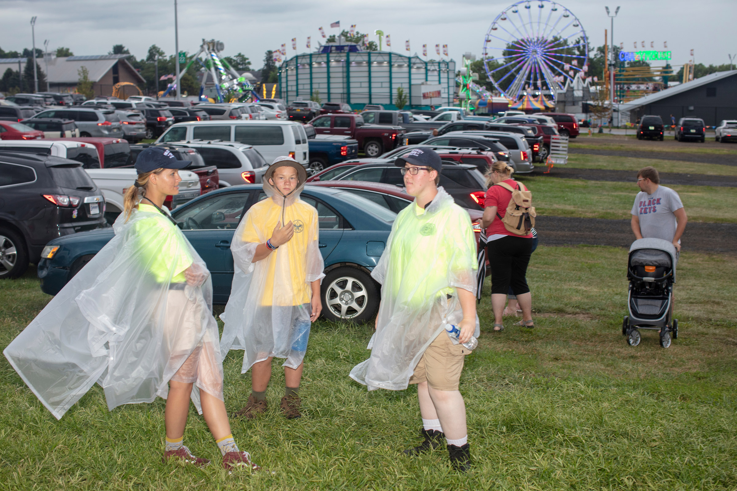 Parking attendants wait for cars at the Iowa State Fair on Aug. 11.