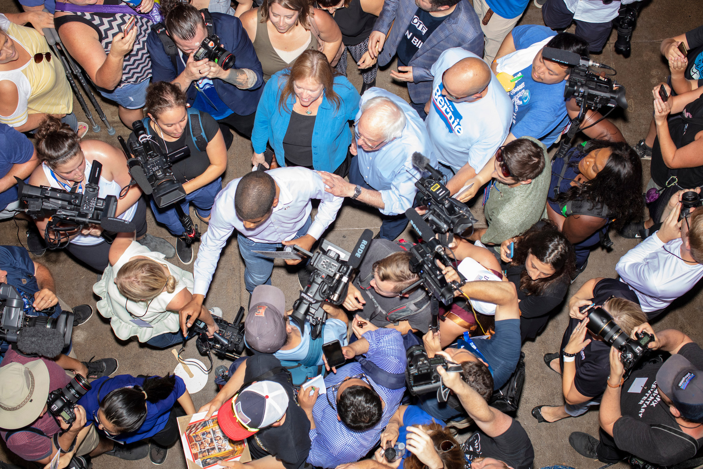 Democratic presidential candidate Bernie Sanders visits the sculpted Butter Cow in the Agriculture Building while surrounded by media and crowds on Aug. 11.