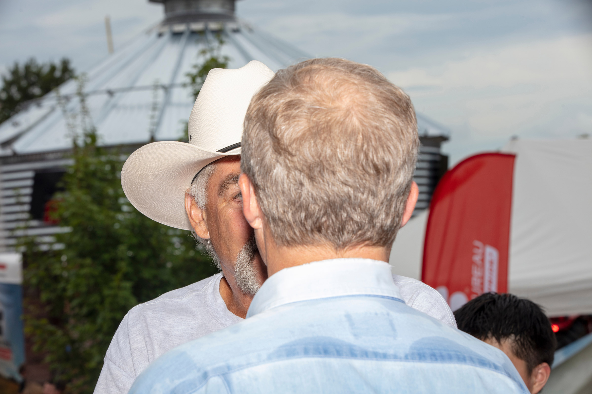 Democratic presidential candidate Tom Steyer speaks with farmer Kyle Gilchrist of Douds, Iowa on Aug. 11. Gilchrist was concerned about how an increasing minimum wage would affect him paying his farm workers.