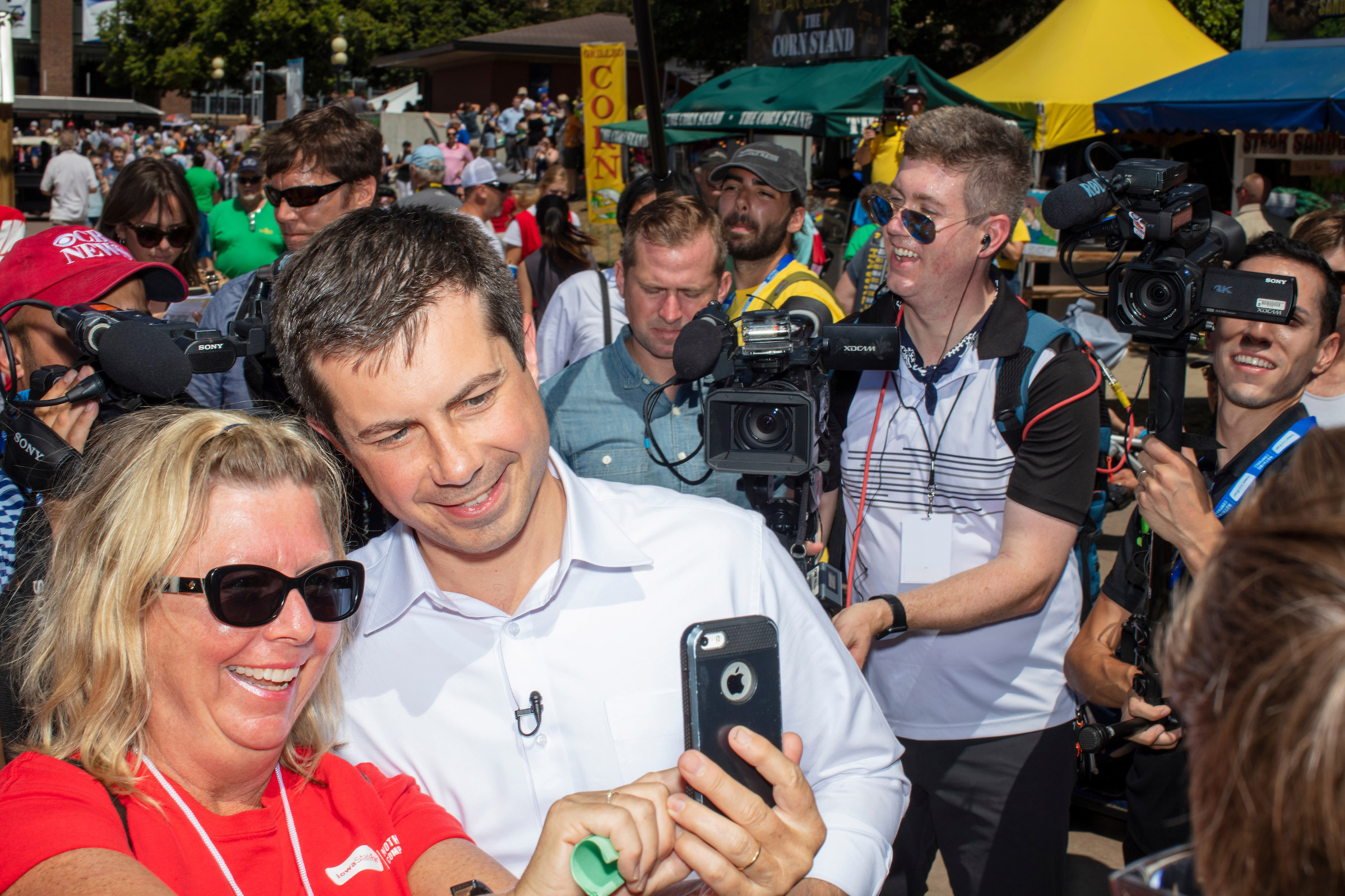 South Bend mayor and Democratic presidential candidate Pete Buttigieg greets people as he walks through the Iowa State Fair on Aug. 13.