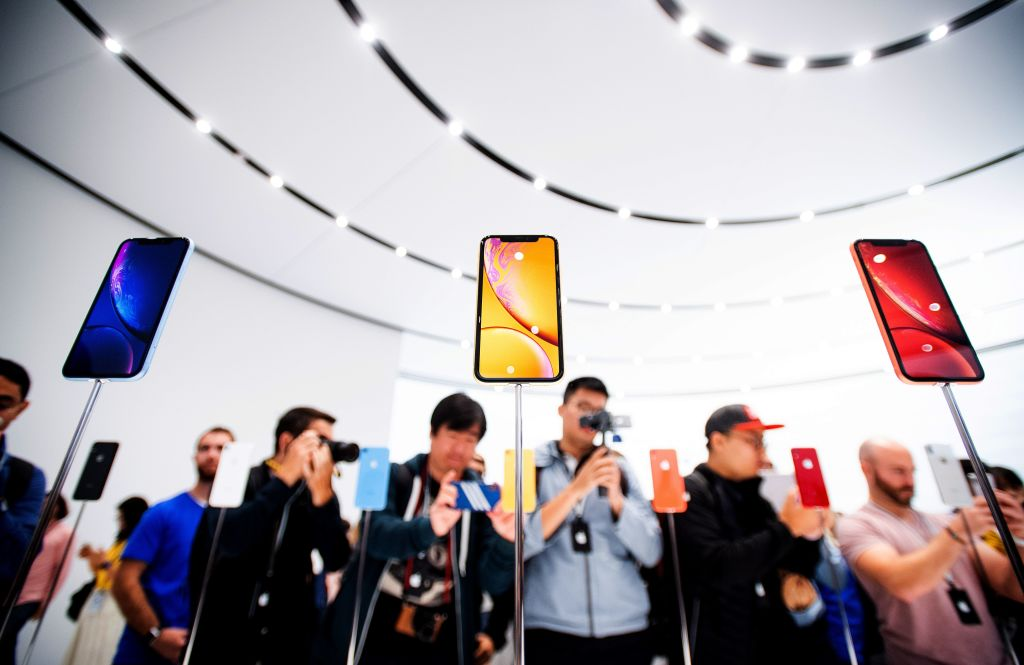 Apple iPhone Xr models rest on display during a launch event on September 12, 2018, in Cupertino, California.