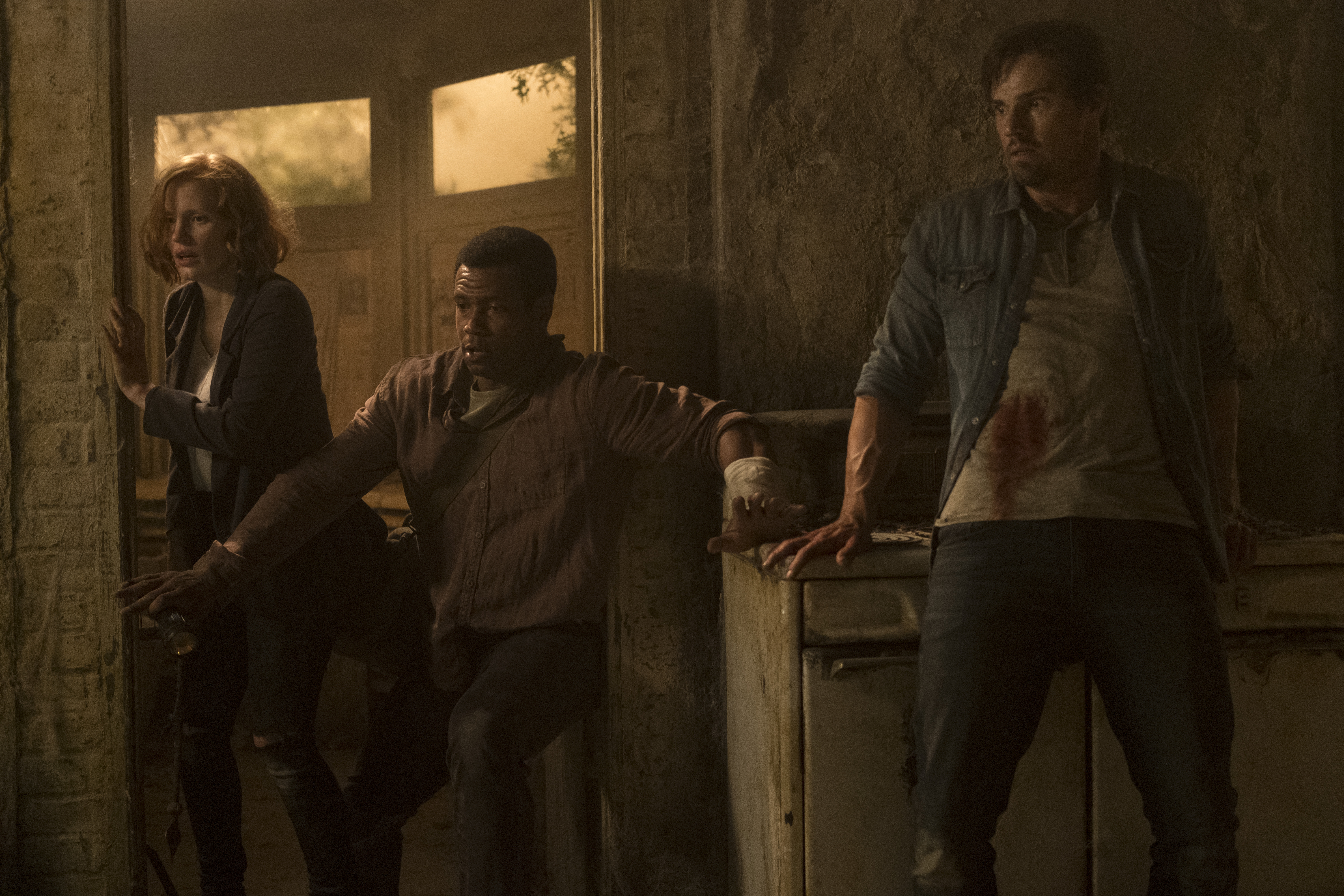 (L-r) Jessica Chastain as Beverly Marsh, Isaiah Mustafa as Mike Hanlon and Jay Ryan as Ben Hanscom in 'It Chapter Two'