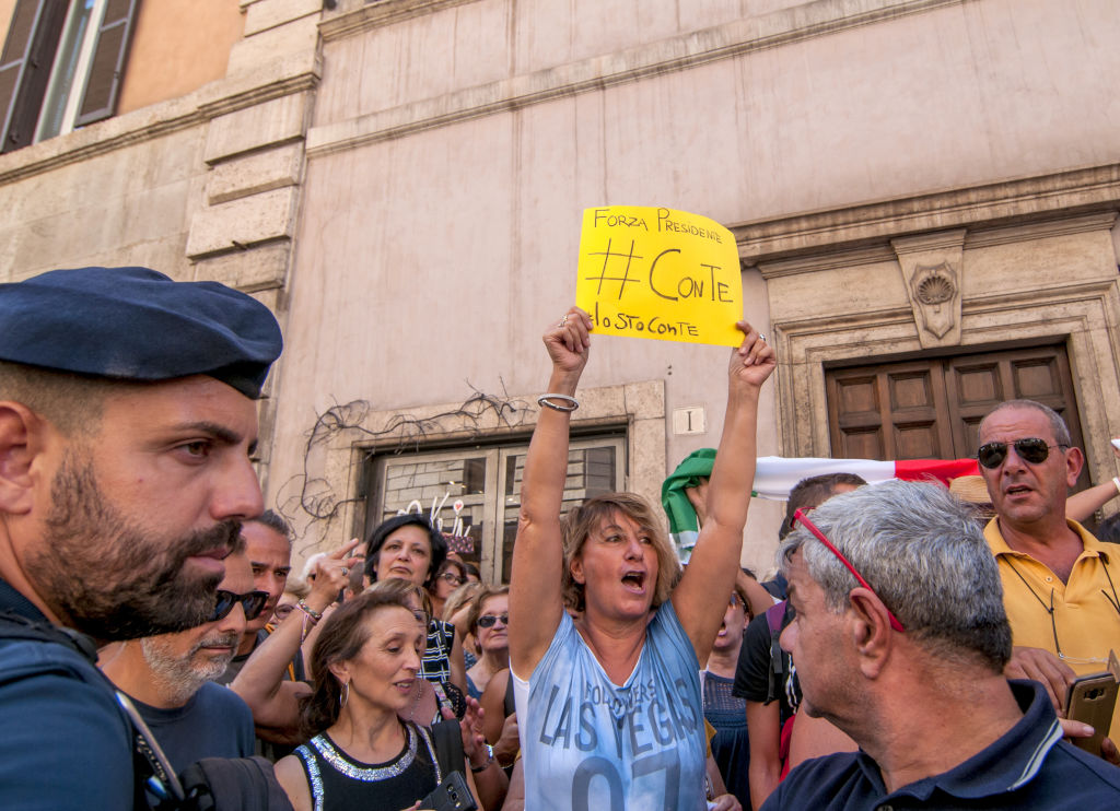 Supporters of the League party and Five Star Movement (in government until now) come out in favor of their leaders outside the main entrance of the Senate in which Prime Minister Giuseppe Conte announced his decision to resign.