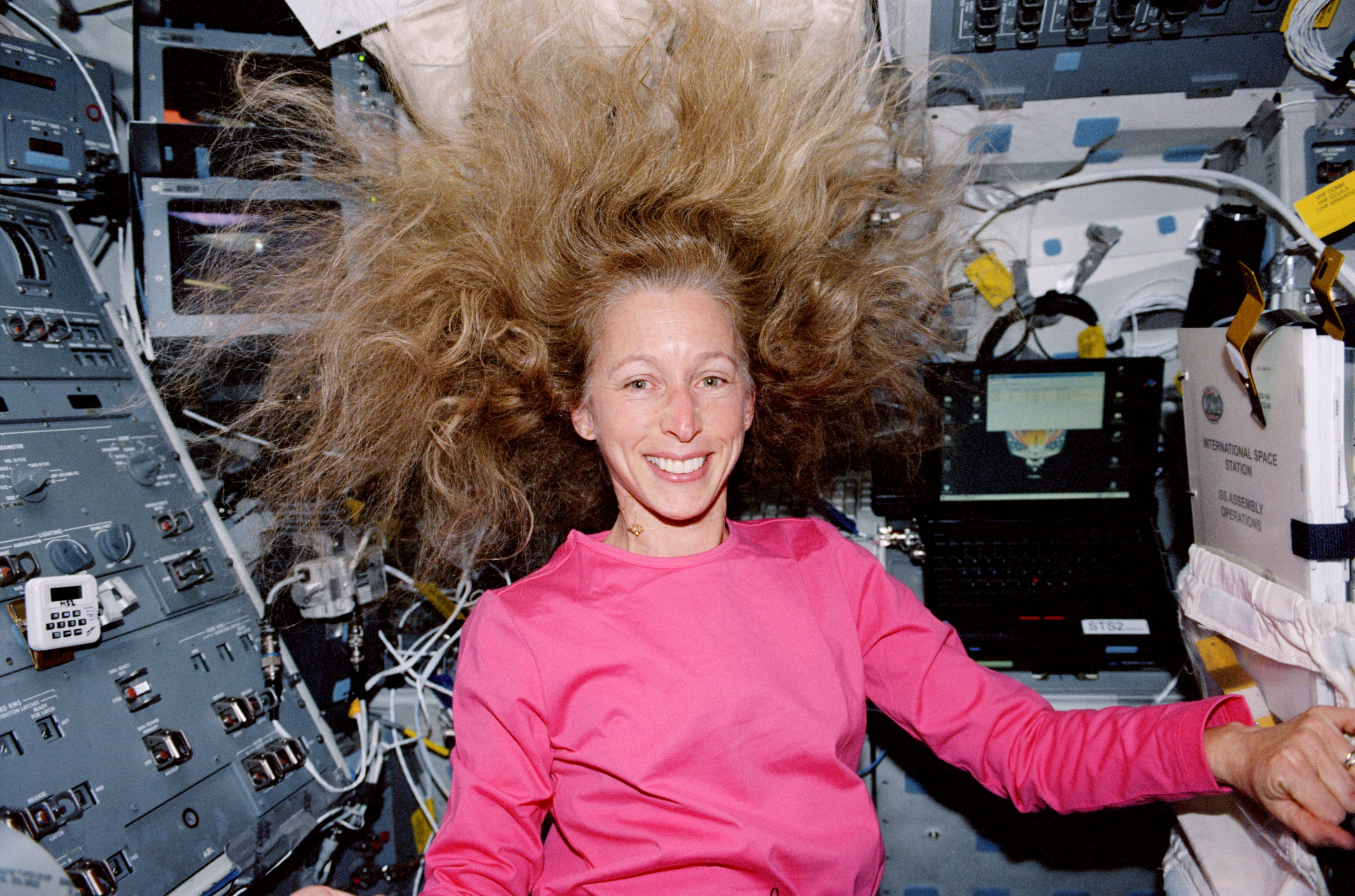 (7-20 February 2001) --- Astronaut Marsha S. Ivins, STS-98 mission specialist, is photographed on the mid deck of the Earth-orbiting Space Shuttle Atlantis.
