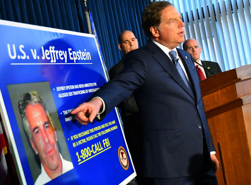 Geoffrey Berman, U.S. attorney for the Southern District of New York, speaks while standing next to a poster displaying the image of fund manager Jeffrey Epstein during a news conference in New York, U.S., on Monday, July 8, 2019.