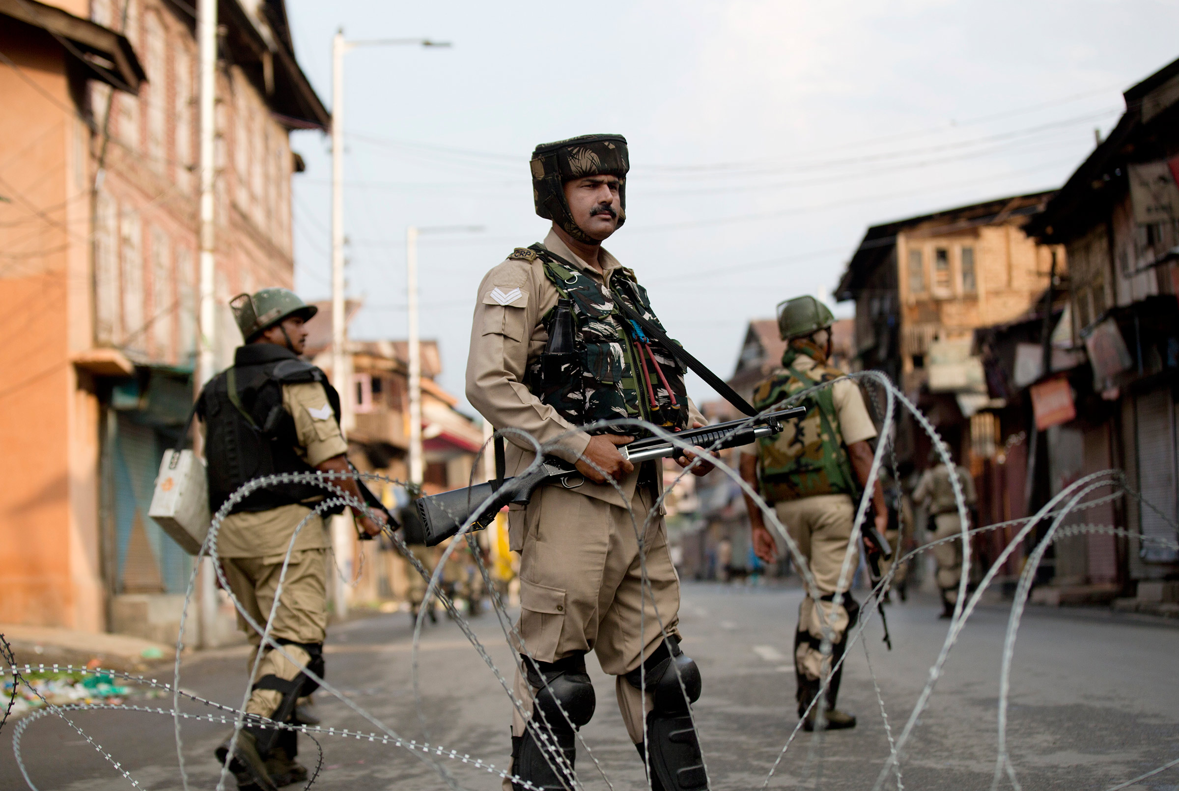 Indian Paramilitary soldiers stand guard during curfew in Srinagar, Indian controlled Kashmir, Wednesday, Aug. 7, 2019.