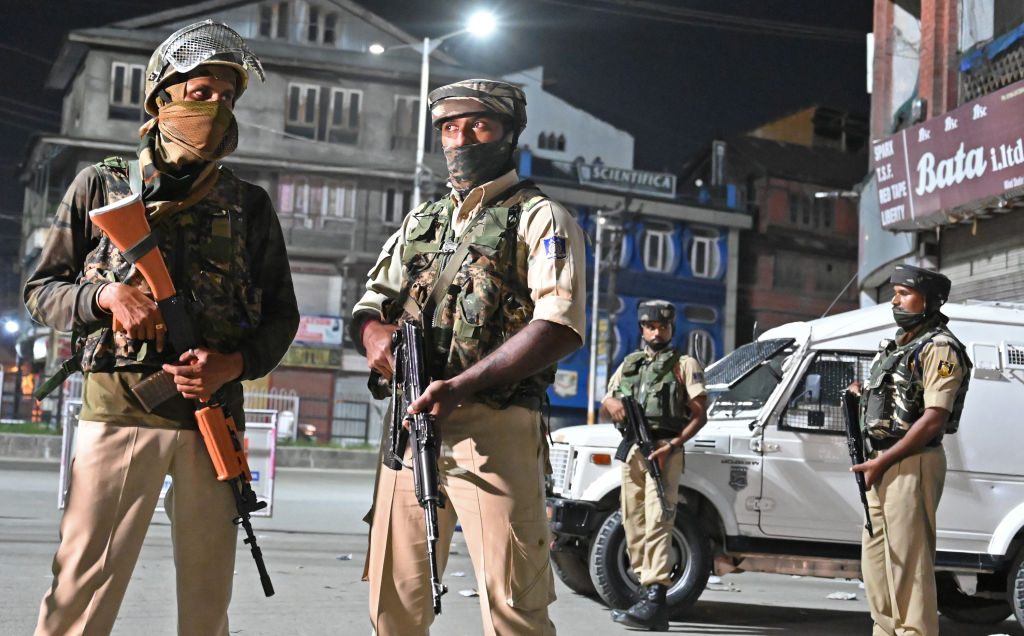 Indian paramilitary troopers stand guard at a roadblock in Srinagar on August 4, 2019.