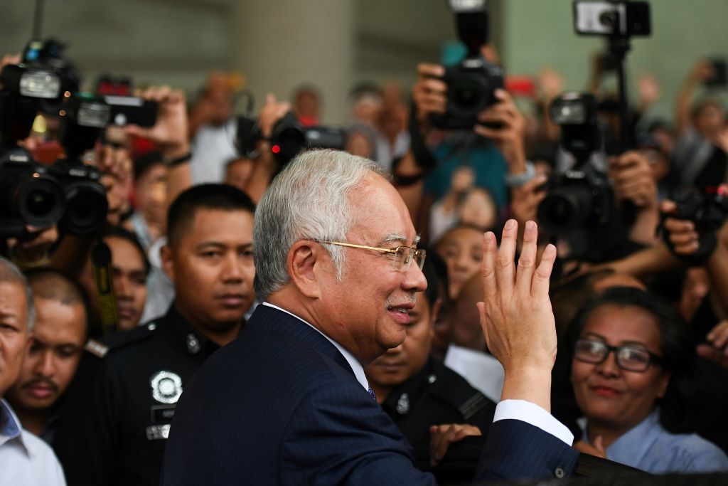 Malaysia's former prime minister Najib Razak waves as he leaves a court in Kuala Lumpur on April 3, 2019.