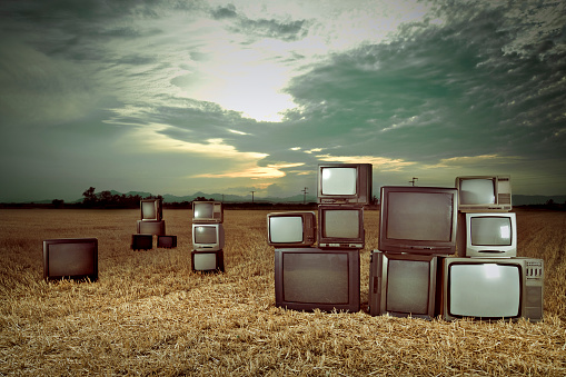 Old televisions outdoors