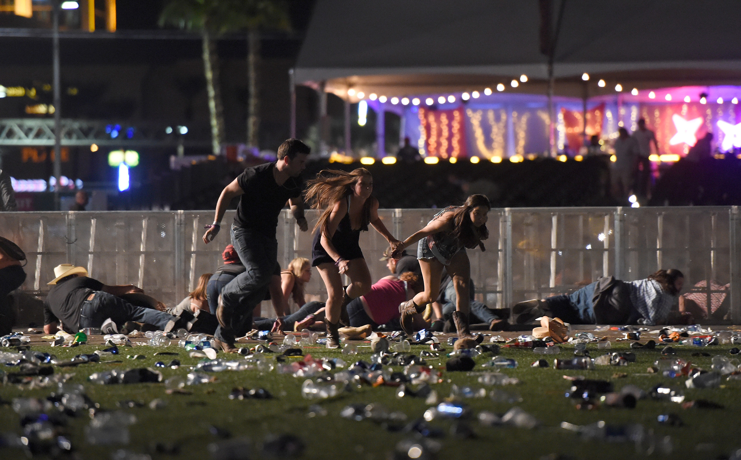 People run from the Route 91 Harvest country music festival after apparent gun fire was heard on Oct. 1, 2017 in Las Vegas.