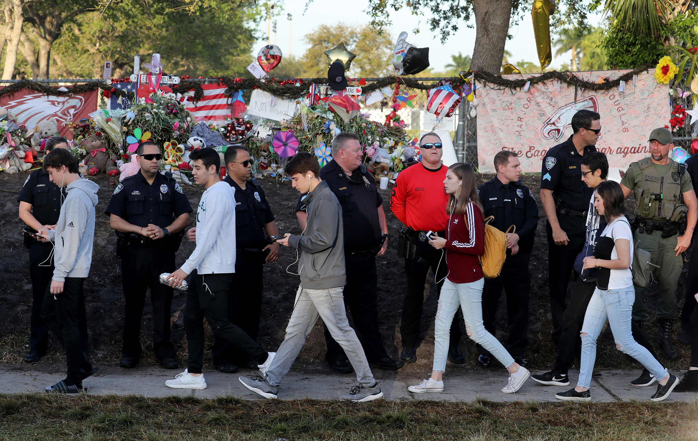 Students head back to school at Marjory Stoneman Douglas High School on Wednesday, Feb. 28, 2018 for the first time after a gunman killed 17 students in the school on Valentine's Day.