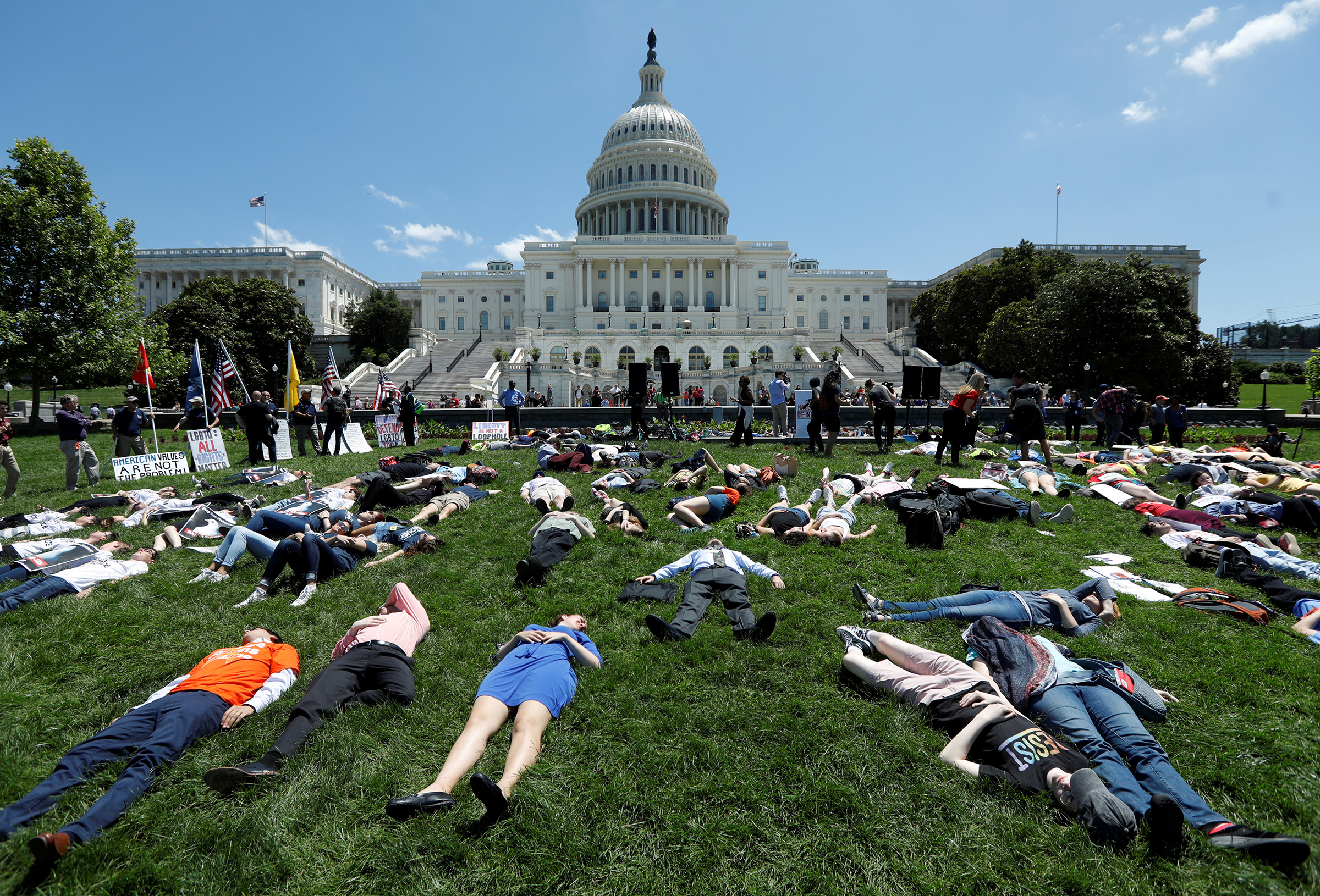 Activists mark the second anniversary of the Pulse Nightclub shooting where a gunman killed 49 people in Orlando with a die-in at the U.S. Capitol in Washington, U.S., June 12, 2018.