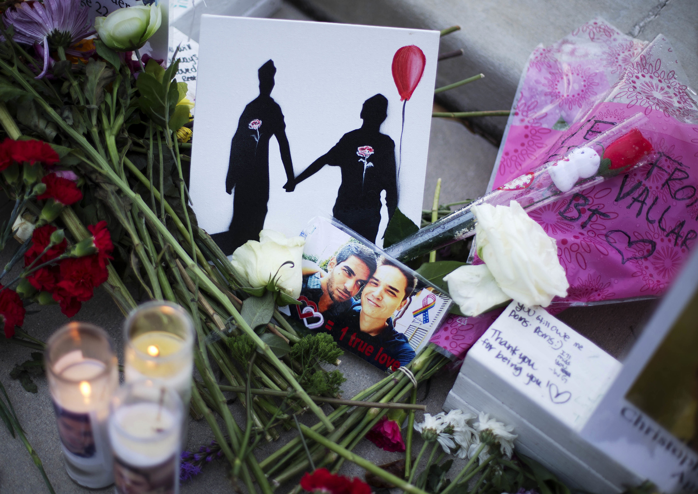 A makeshift memorial to Christopher Andrew Leinonen (R) and his boyfriend Juan Ramon Guerrero (L) on June 19, 2019. They were both killed in the Pulse nightclub mass shooting in Orlando.