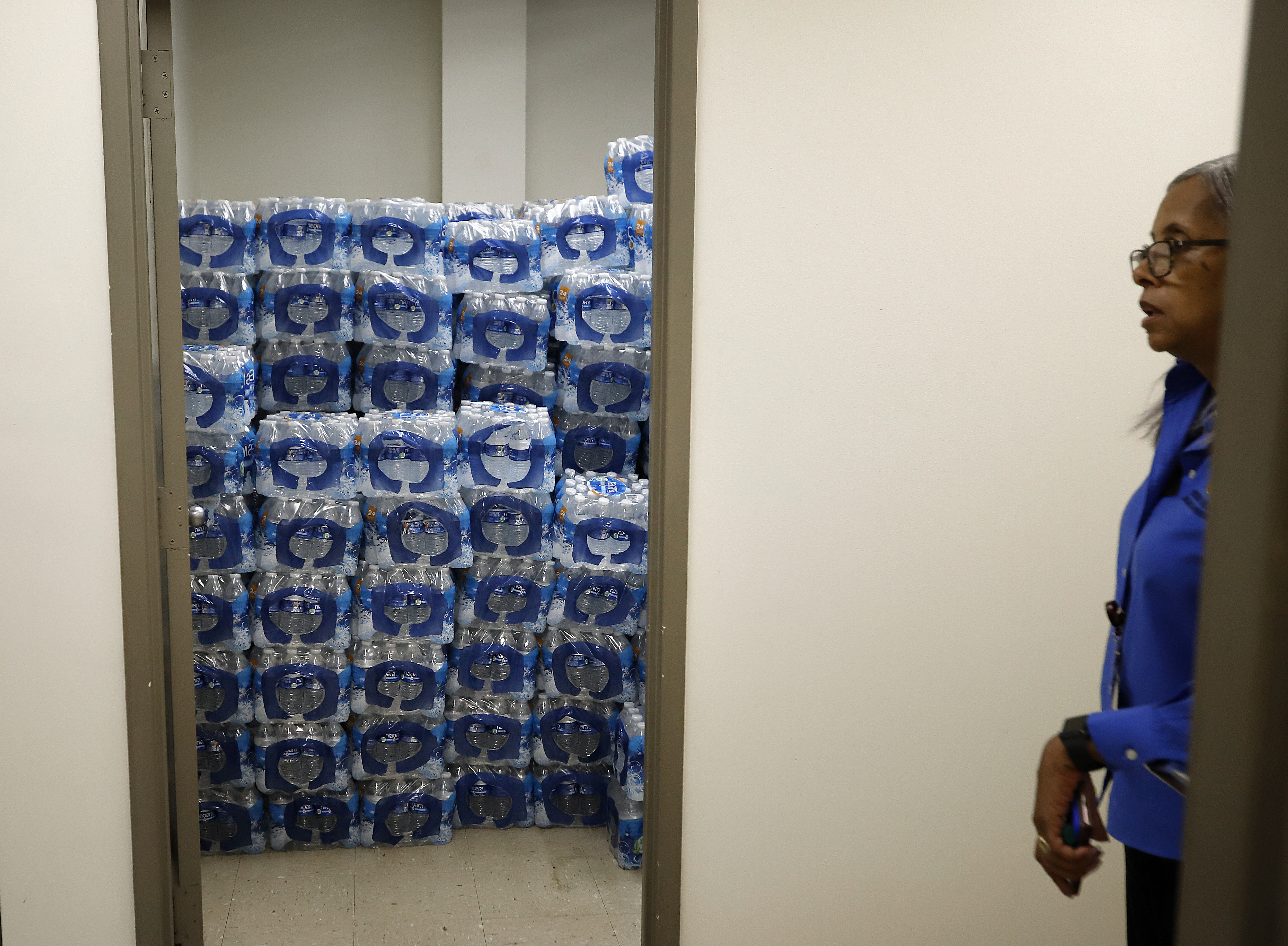 Water is stacked in several rooms scattered around the Newark Health Department, which is acting as a distribution point for fresh water for residents affected by the city's ongoing water crisis due to lead contamination in some tap water.