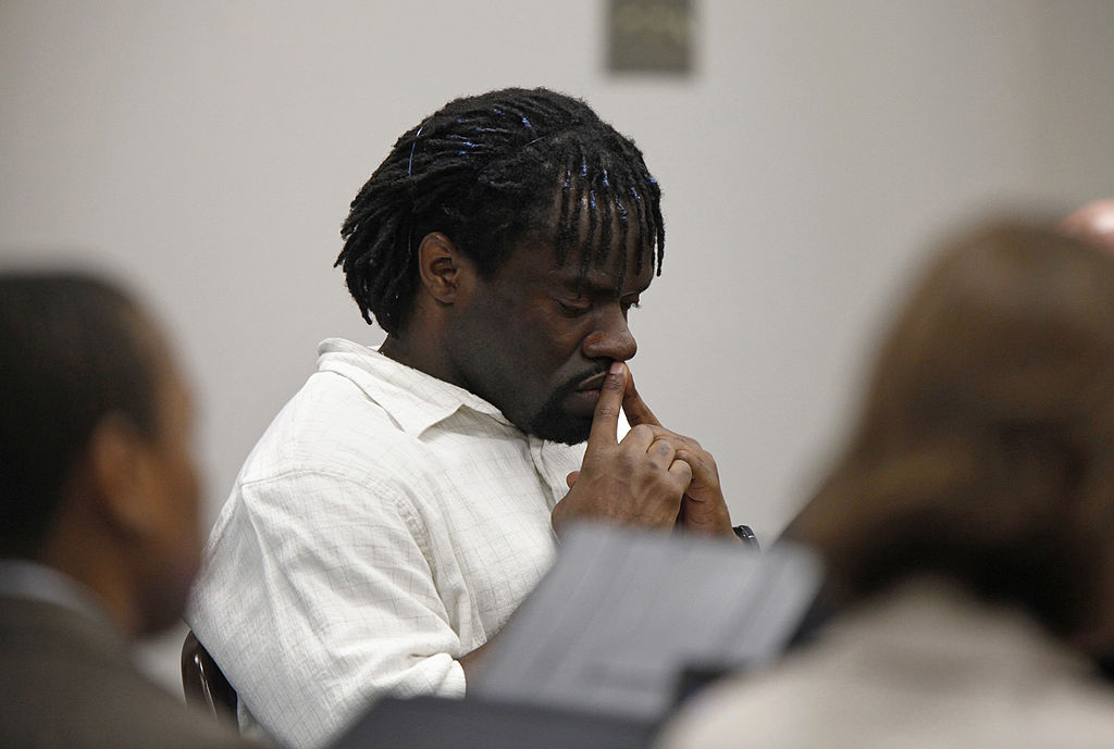 Death row inmate Marcus Robinson listening as Judge Greg Weeks found that racial bias played a role in his trial on Friday, April 20, 2012, in Fayetteville, North Carolina.