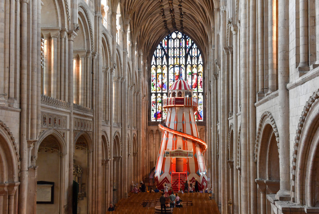 People view a 40ft helter skelter installed inside Norwich Cathedral as part of the Seeing It Differently project which aims to give people the chance to experience the Cathedral in an entirely new way.