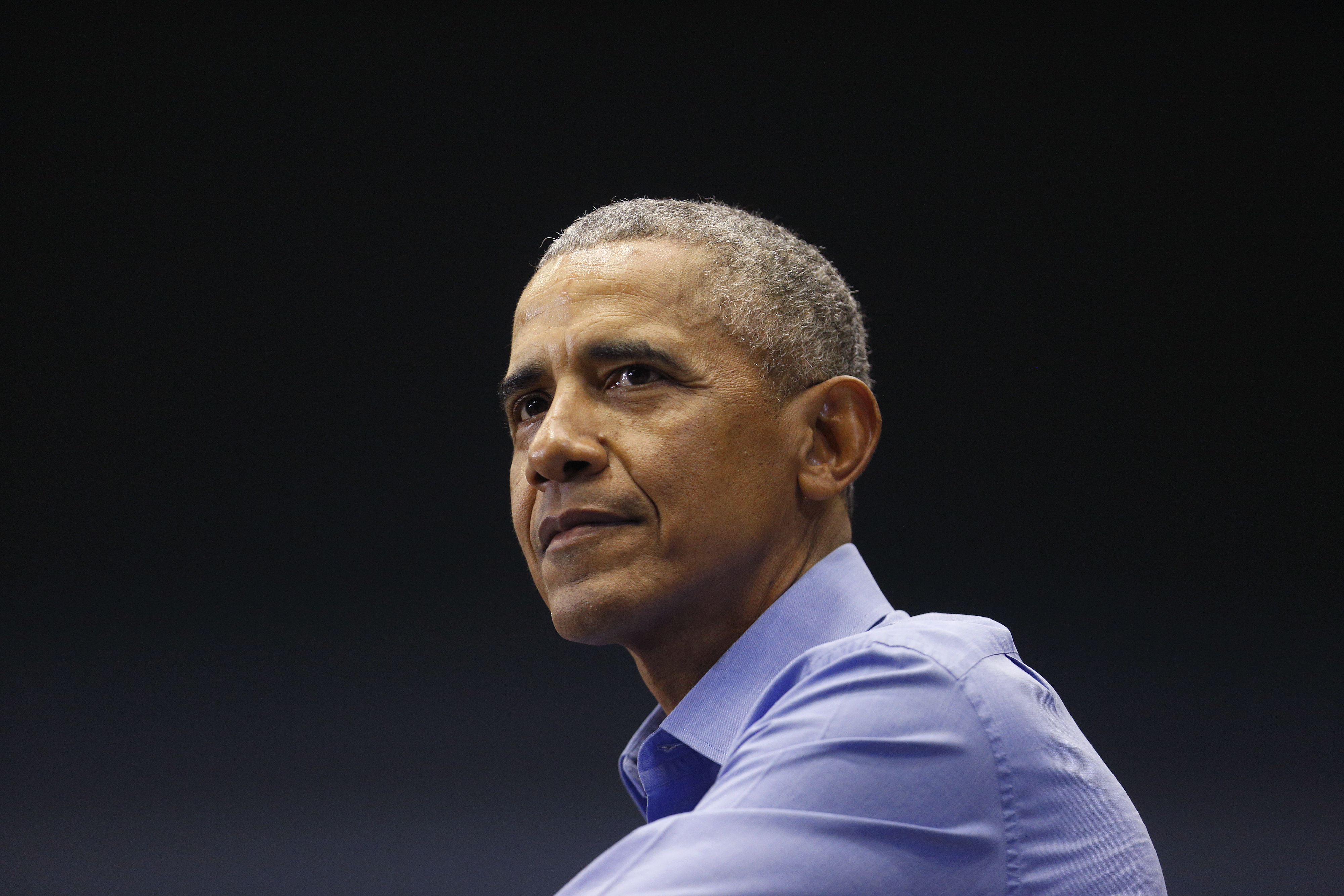 Former U.S. President Barack Obama pauses while speaking during a campaign rally in Gary, Indiana, U.S., on Sunday, Nov. 4, 2018.