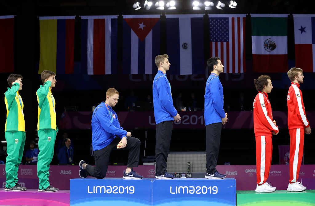 Gold medalist Race Imboden of the U.S. takes a knee during the National Anthem Ceremony on Day 14 of Lima 2019 Pan American Games on August 09, 2019 in Lima, Peru.