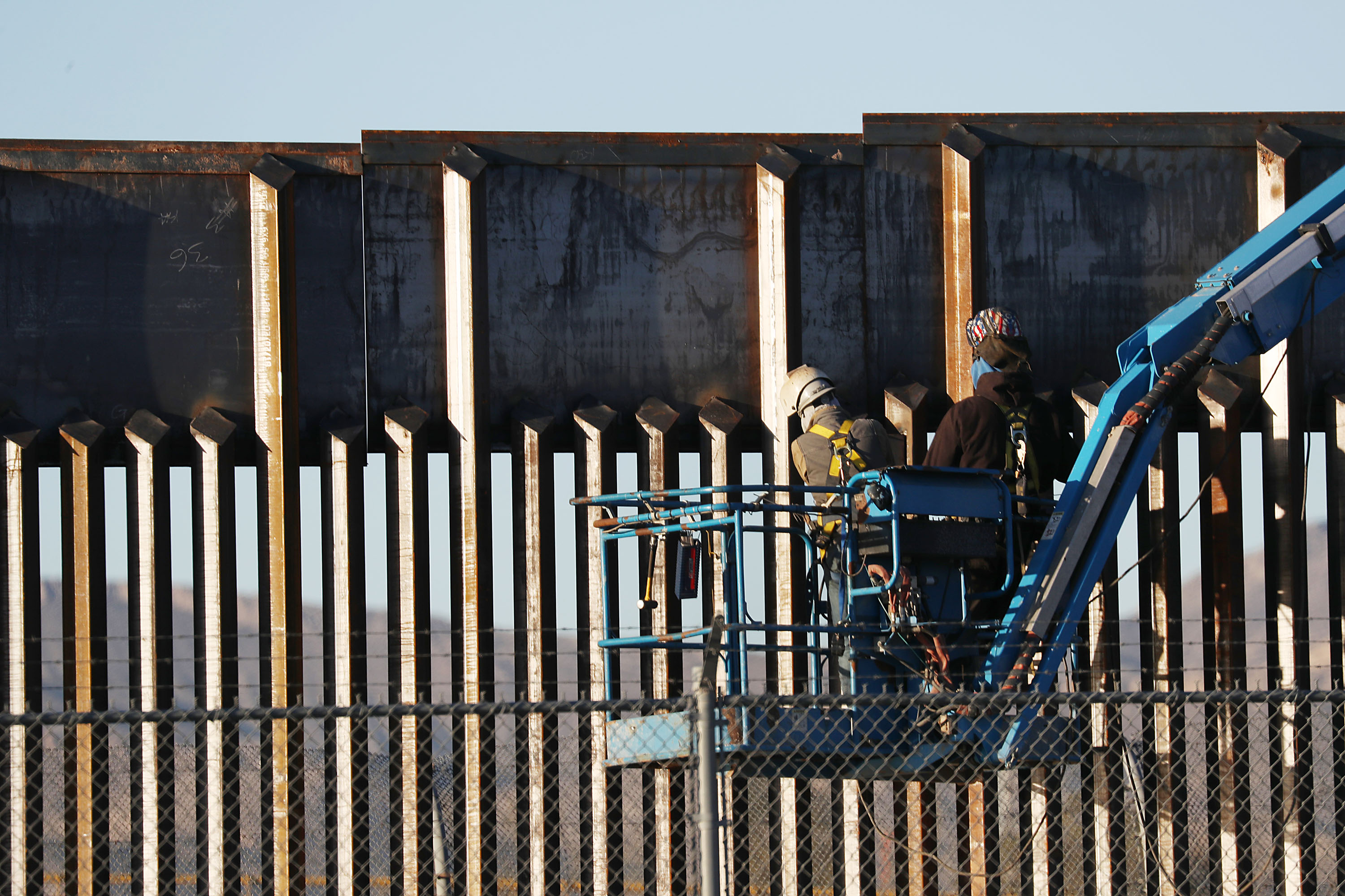 People work on the U.S./ Mexican border wall on February 12, 2019 in El Paso, Texas.
