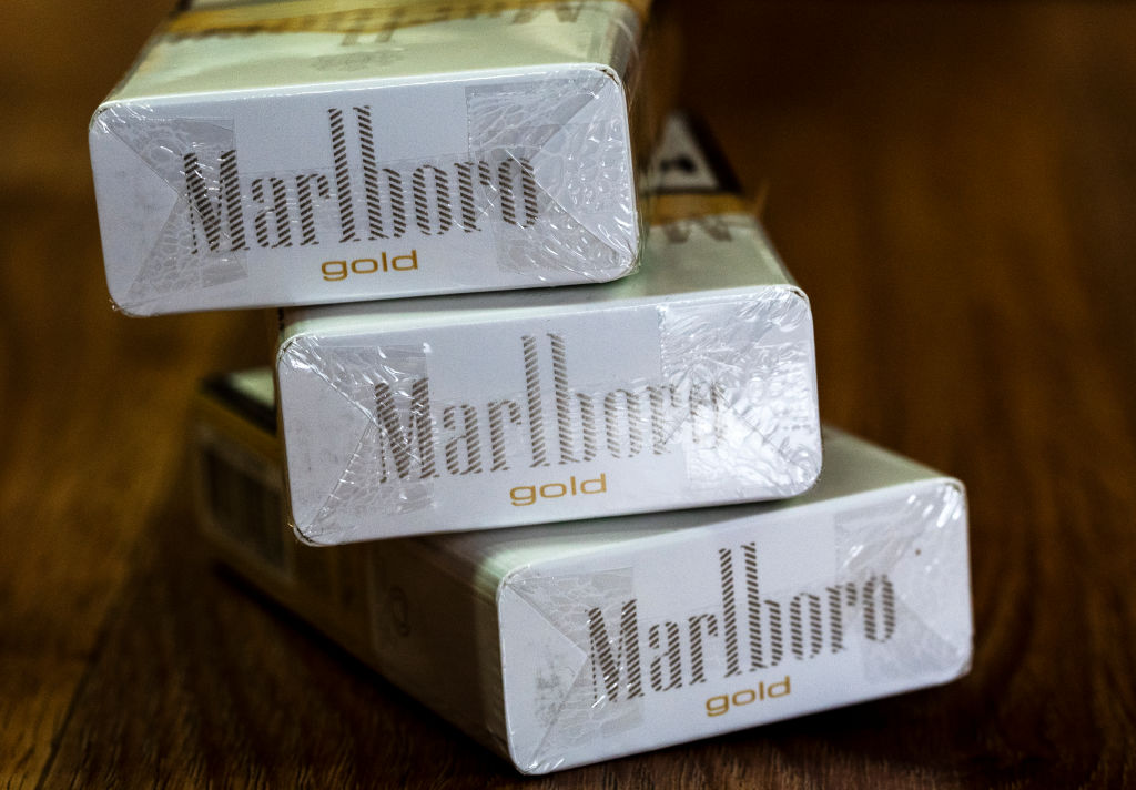 A pack of Philip Morris International Inc. Marlboro Gold cigarettes seen in a tobacco store in Kiev, Ukraine, on Feb. 14, 2019. The overseas maker of Marlboro cigarettes may merge again with Altria Group Inc.