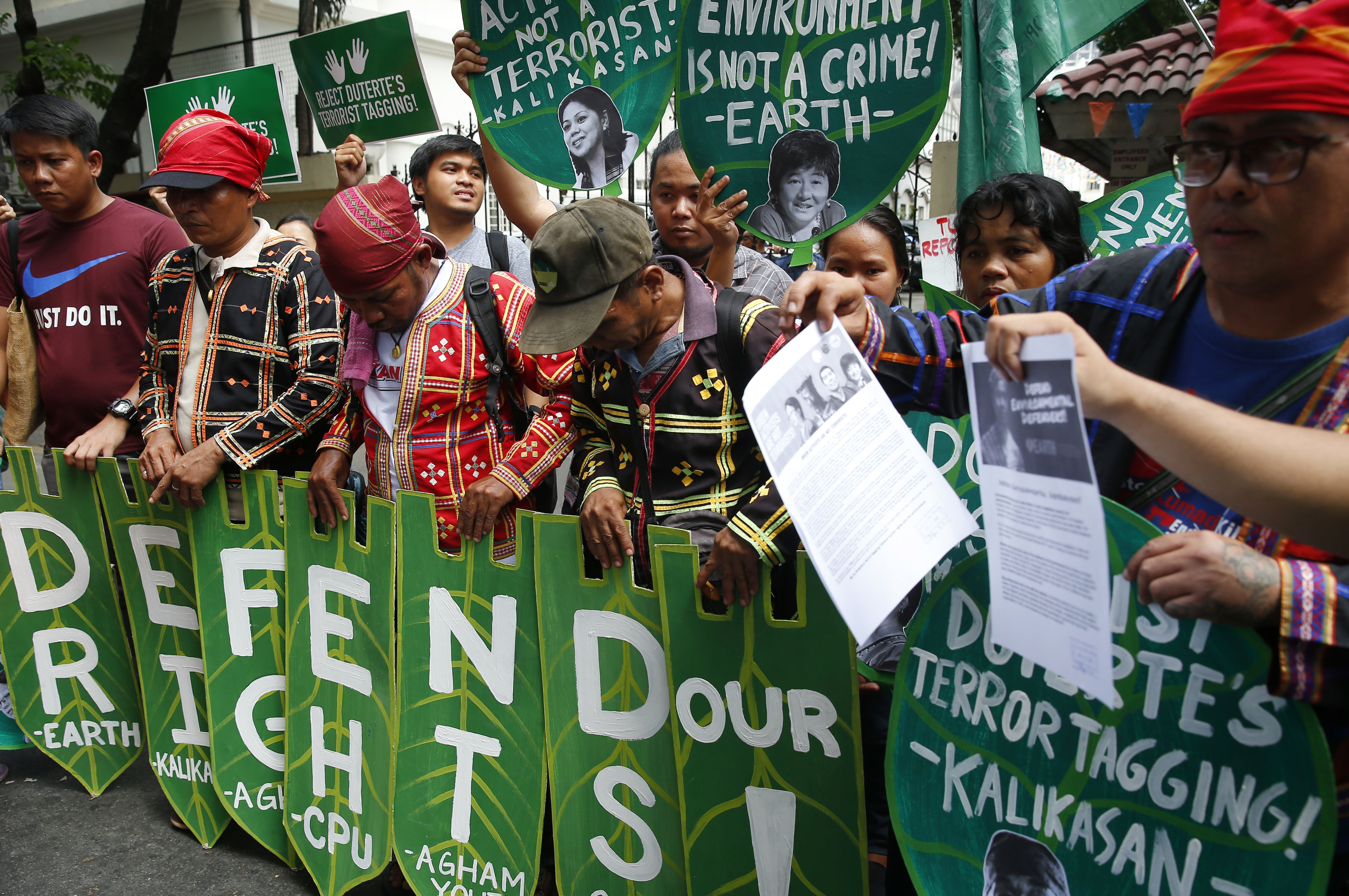 Environmental activists display placards during a rally at the Department of Justice to demand the Philippine government withdraw its alleged list of  terrorists  which includes more than three dozen environmentalists in Manila, Philippines on April 20, 2018.