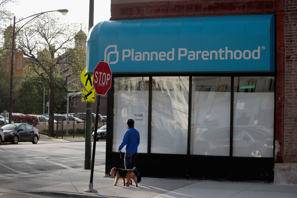 A sign hangs over the front of a Planned Parenthood clinic in Chicago, Illinois in May 2018, when the Trump administration announced new Title X regulations.