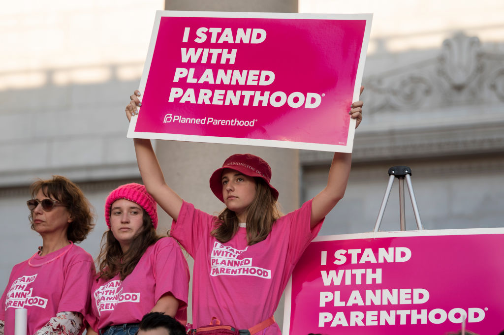 Supporters of Planned Parenthood gather to call on Congress not to ban people on Medicaid from receiving care at Planned Parenthood health centers. Los Angeles, California on June 21, 2017.