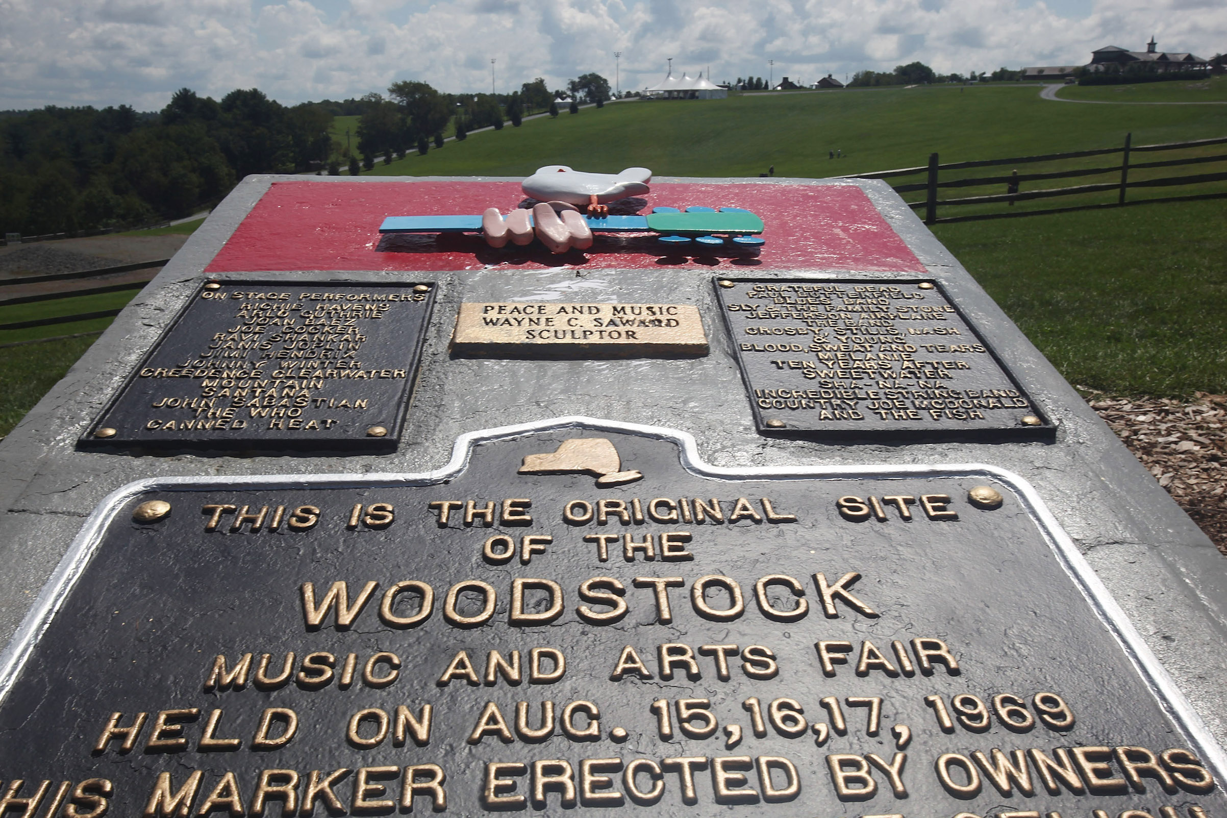 A plaque marks the original site of the Woodstock music festival, seen Aug. 14, 2009 in Bethel, N.Y.
