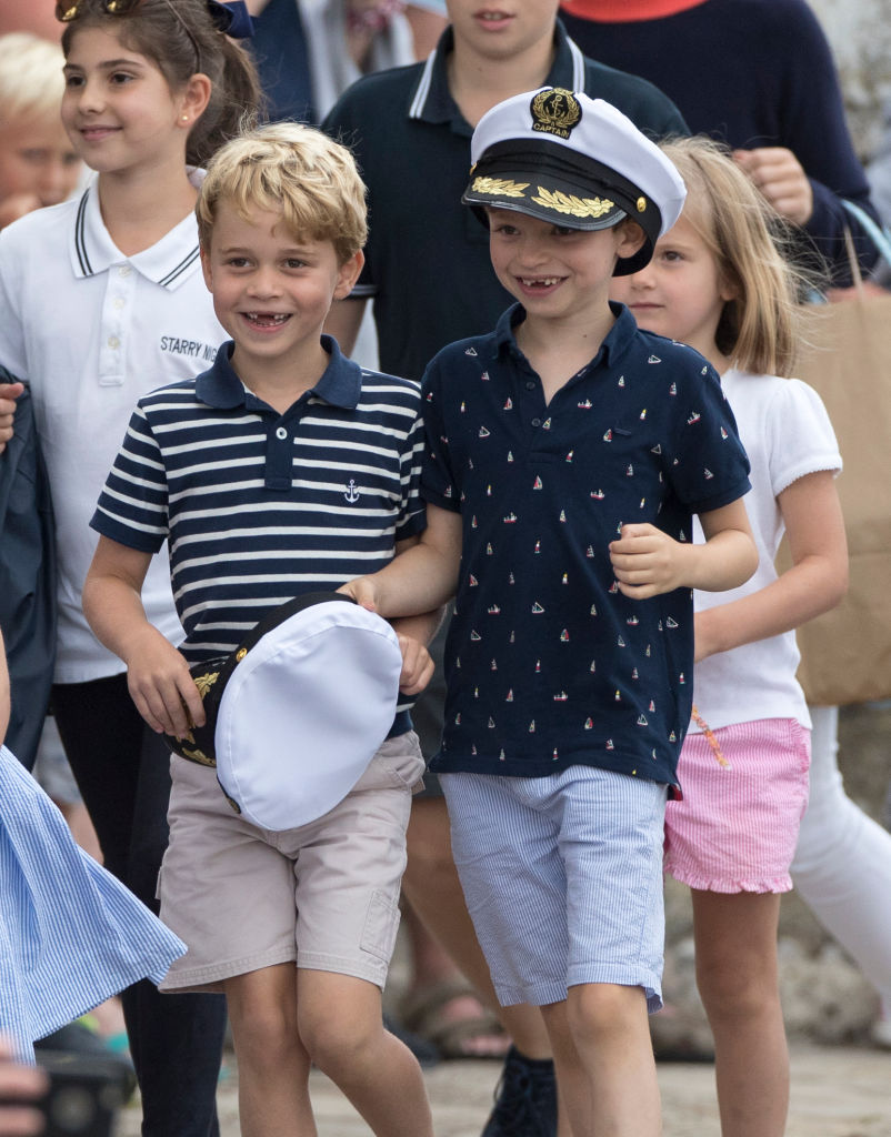 Prince George (L) at The Royal Yacht Squadron during the inaugural Kings Cup regatta hosted by the Duke and Duchess of Cambridge on August 08, 2019 in Cowes, England.