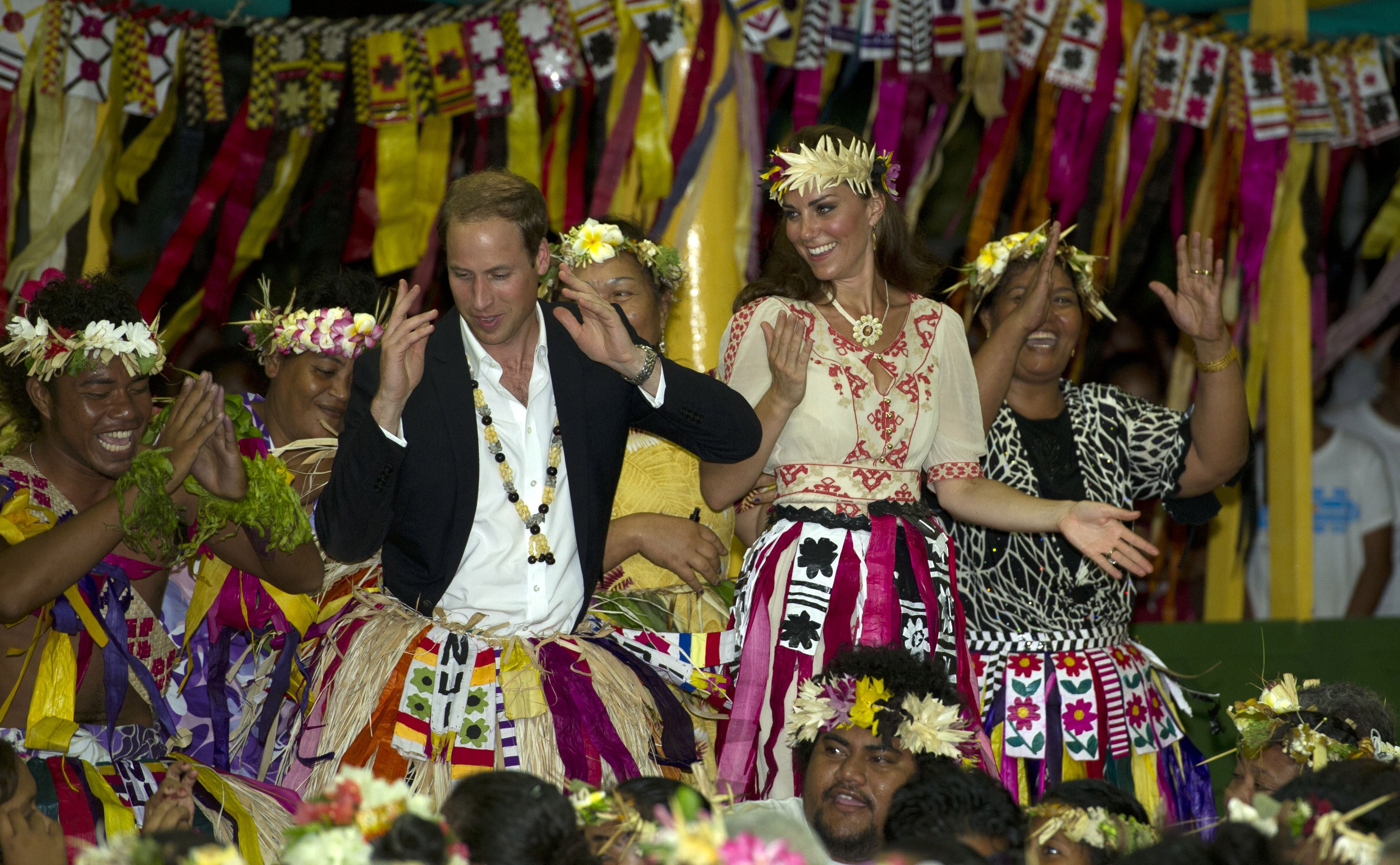 Prince William, Duke of Cambridge and Catherine, Duchess of Cambridge and dance with local ladies at a Vaiku Falekaupule Ceremony during the Royal couple's Diamond Jubilee tour of the Far East on September 18, 2012 in Funafuti, Tuvalu.