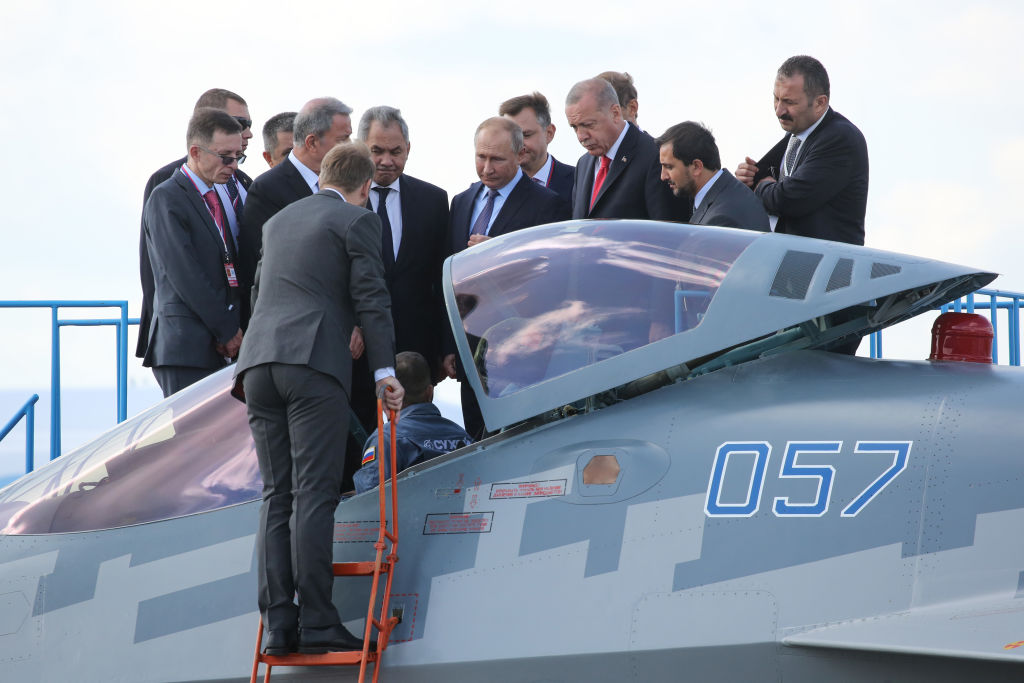 Vladimir Putin, Russia's president, center left, and Recep Tayyip Erdogan, Turkey's president, center right, inspect a Sukhoi Su-57 fighter jet at the MAKS International Aviation and Space Salon at Zhukovsky International Airport in Moscow, Russia, on Tuesday, Aug. 27, 2019.