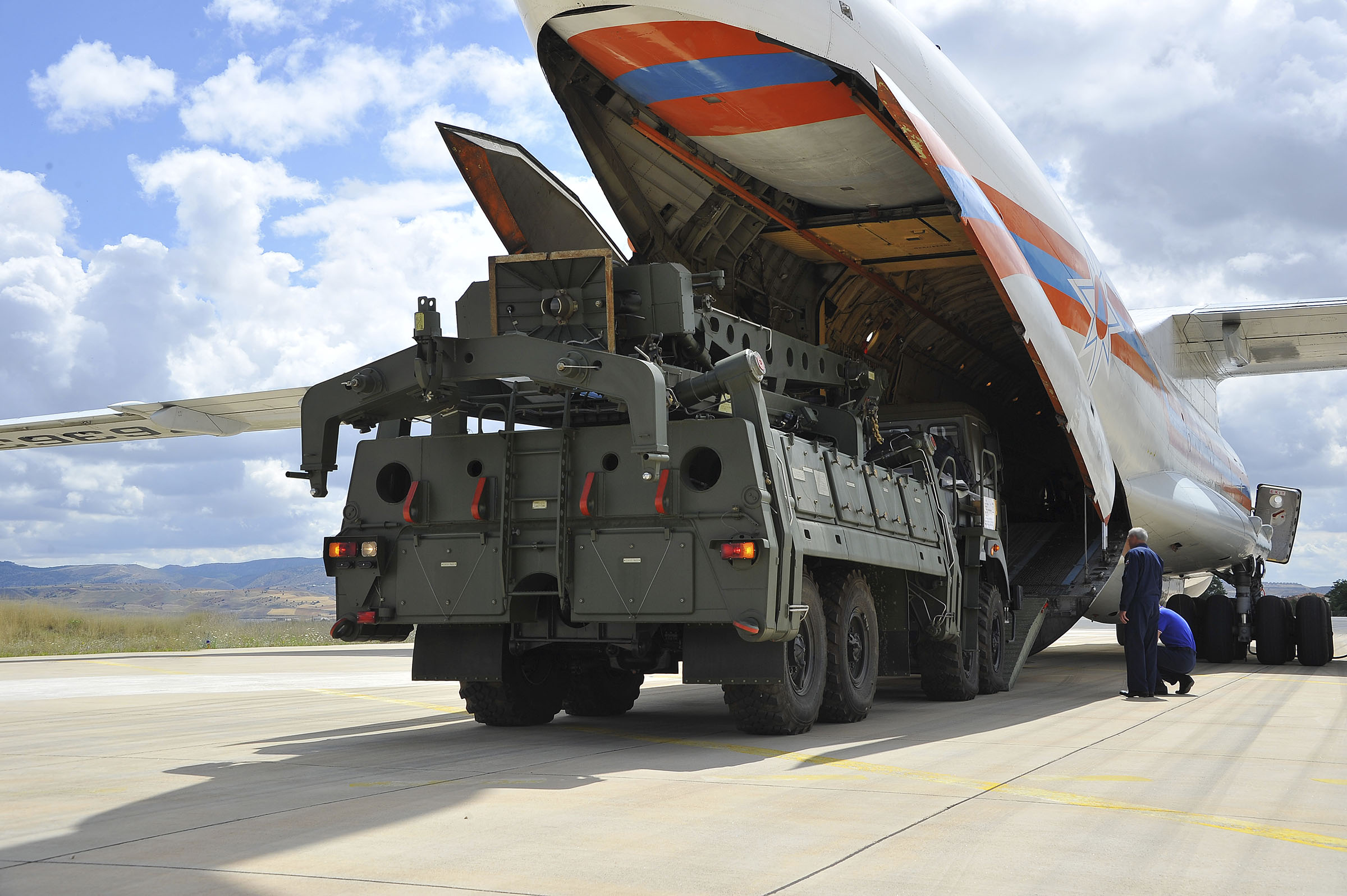 Military vehicles and equipment, parts of the S-400 air defense systems, are unloaded from a Russian transport aircraft, at Murted military airport in Ankara, Turkey on July 12, 2019.