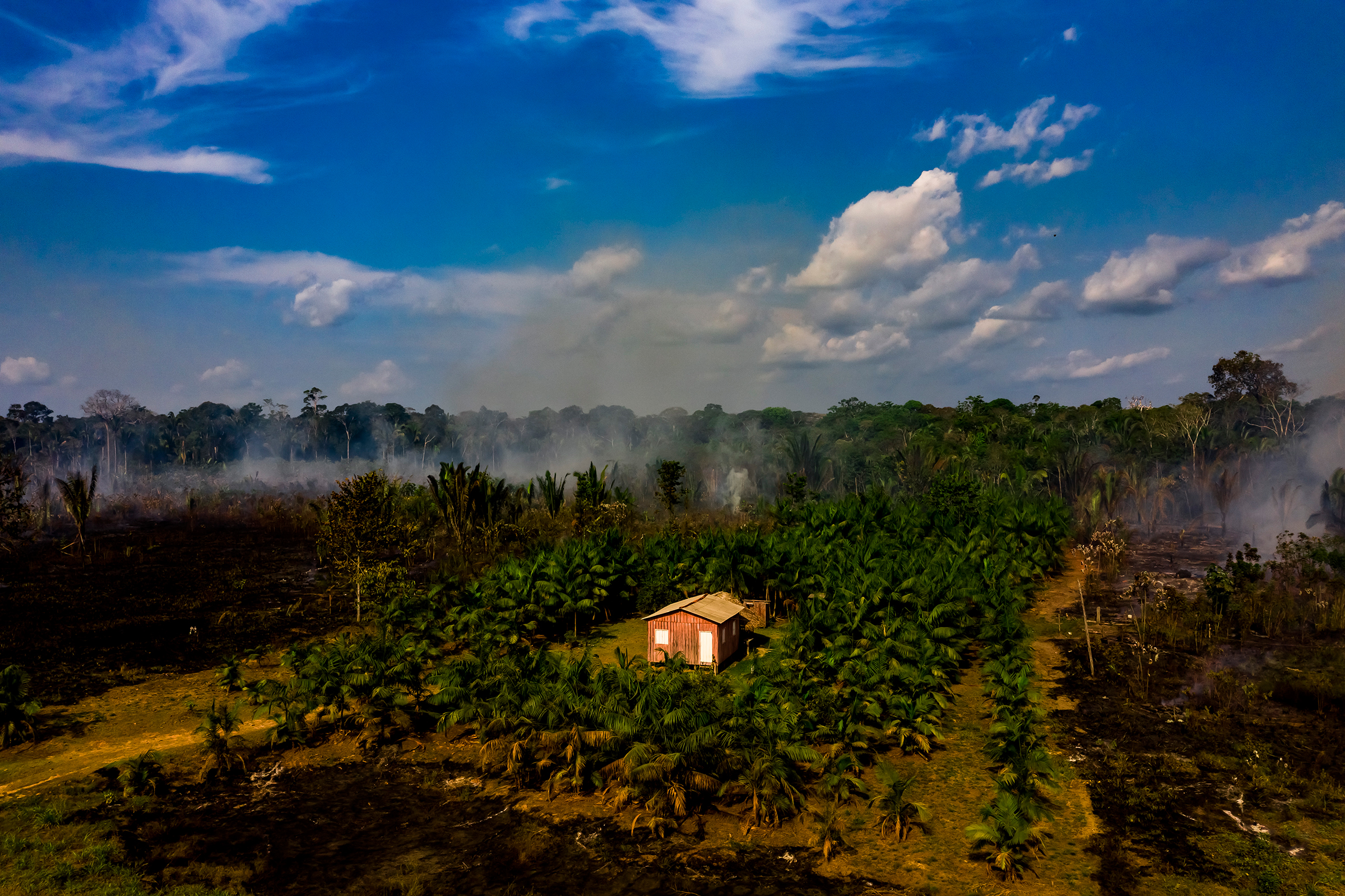 Smoke rises from a recent fire near Realidade on Aug. 26.