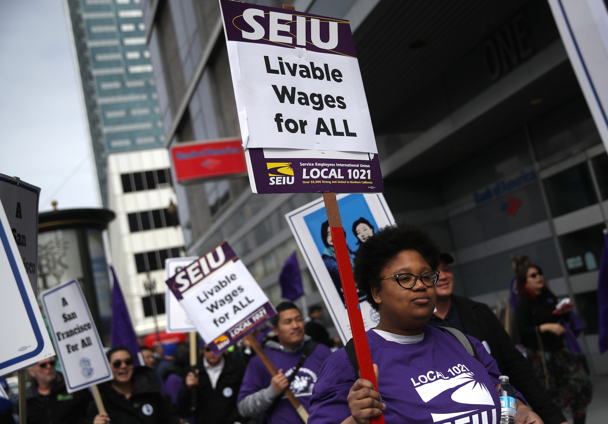 San Francisco city workers carry signs as they march during a rally outside the City and County of San Francisco Human Resources office on March 7, 2019, in San Francisco. Hundreds of San Francisco city workers staged a rally to demand a fair contract that addresses pay equity for women. Public-sector employment is a major factor in the race and gender wage gap.