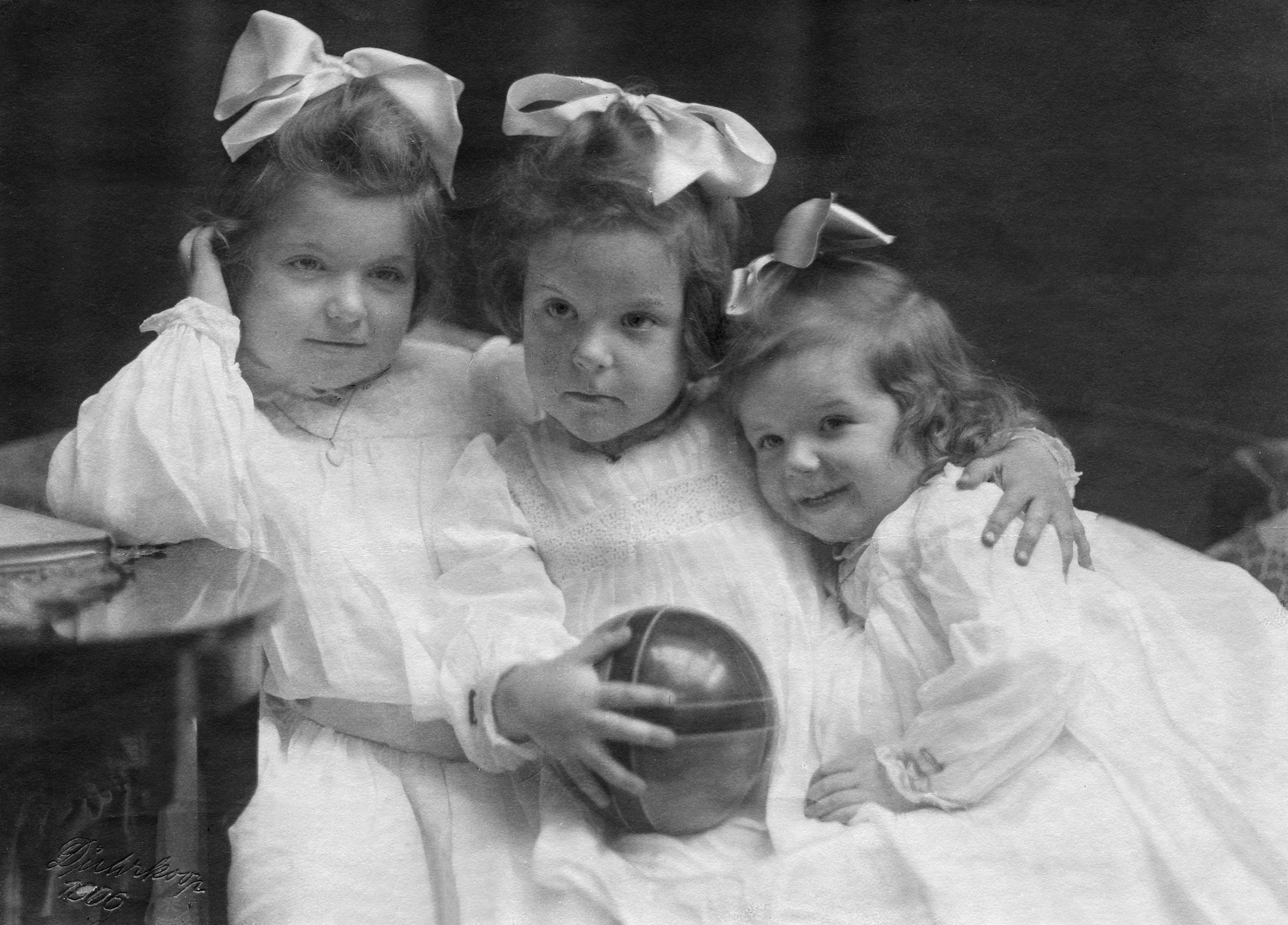 Three sisters with hair bows, 1906.