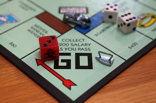 The Monopoly iron game piece is displayed on the Monopoly game board in Fairfax, California on February 6, 2013.