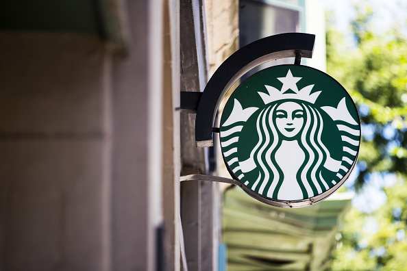 Signage is displayed outside a Starbucks in Boston, Massachusetts, U.S., on Sunday, July 21, 2019.
