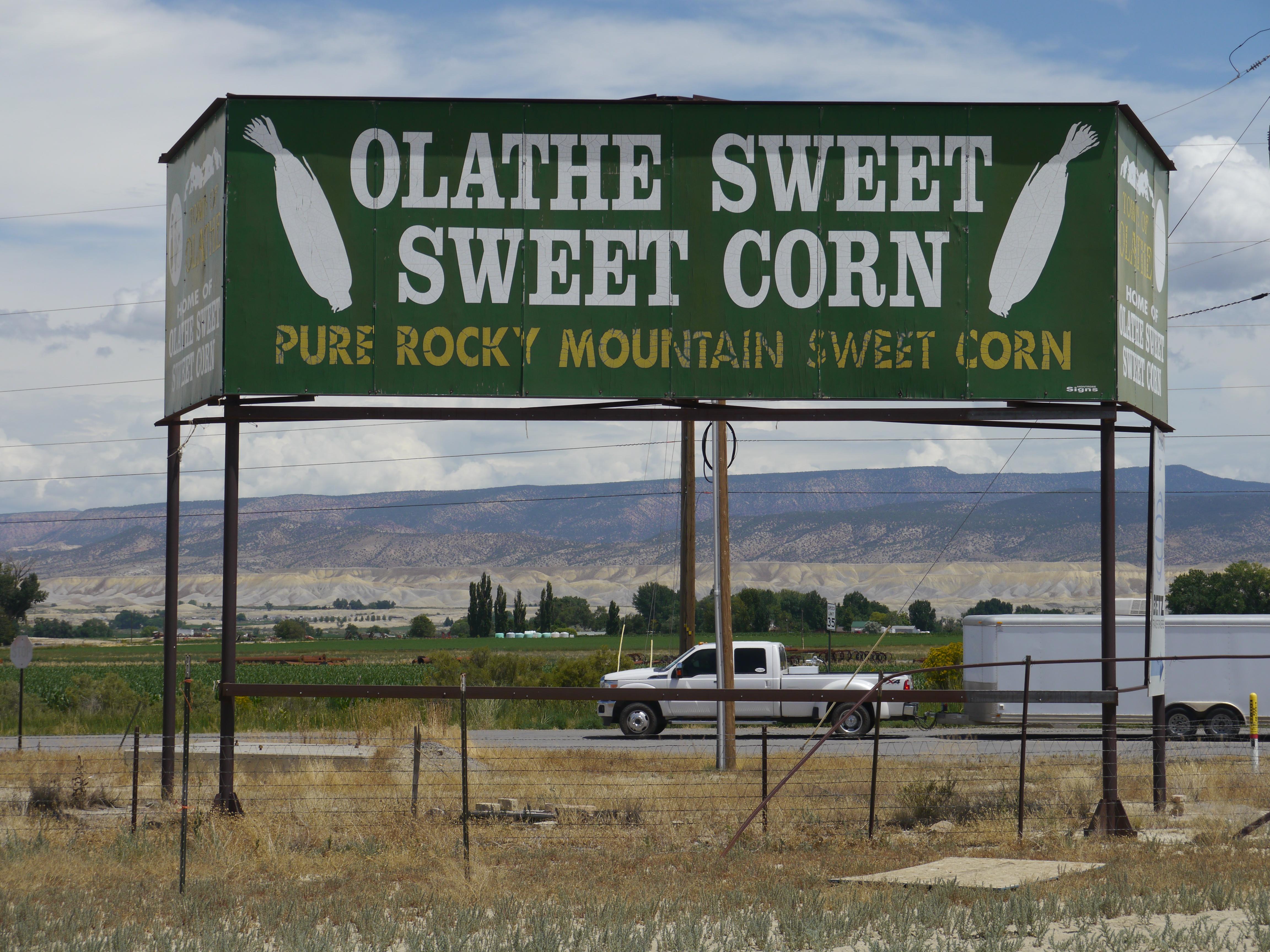 A billboard for David Harold's family farm in Colorado, Olathe Sweet Sweet Corn.