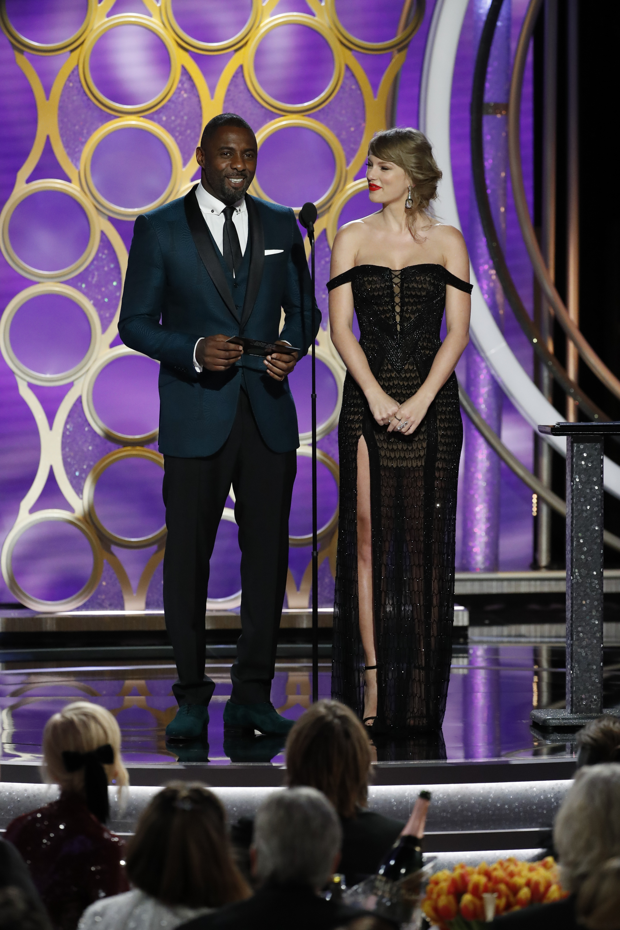 Presenters Taylor Swift and Idris Elba speak onstage during the 76th Annual Golden Globe Awards at The Beverly Hilton Hotel on January 06, 2019 in Beverly Hills, California.
