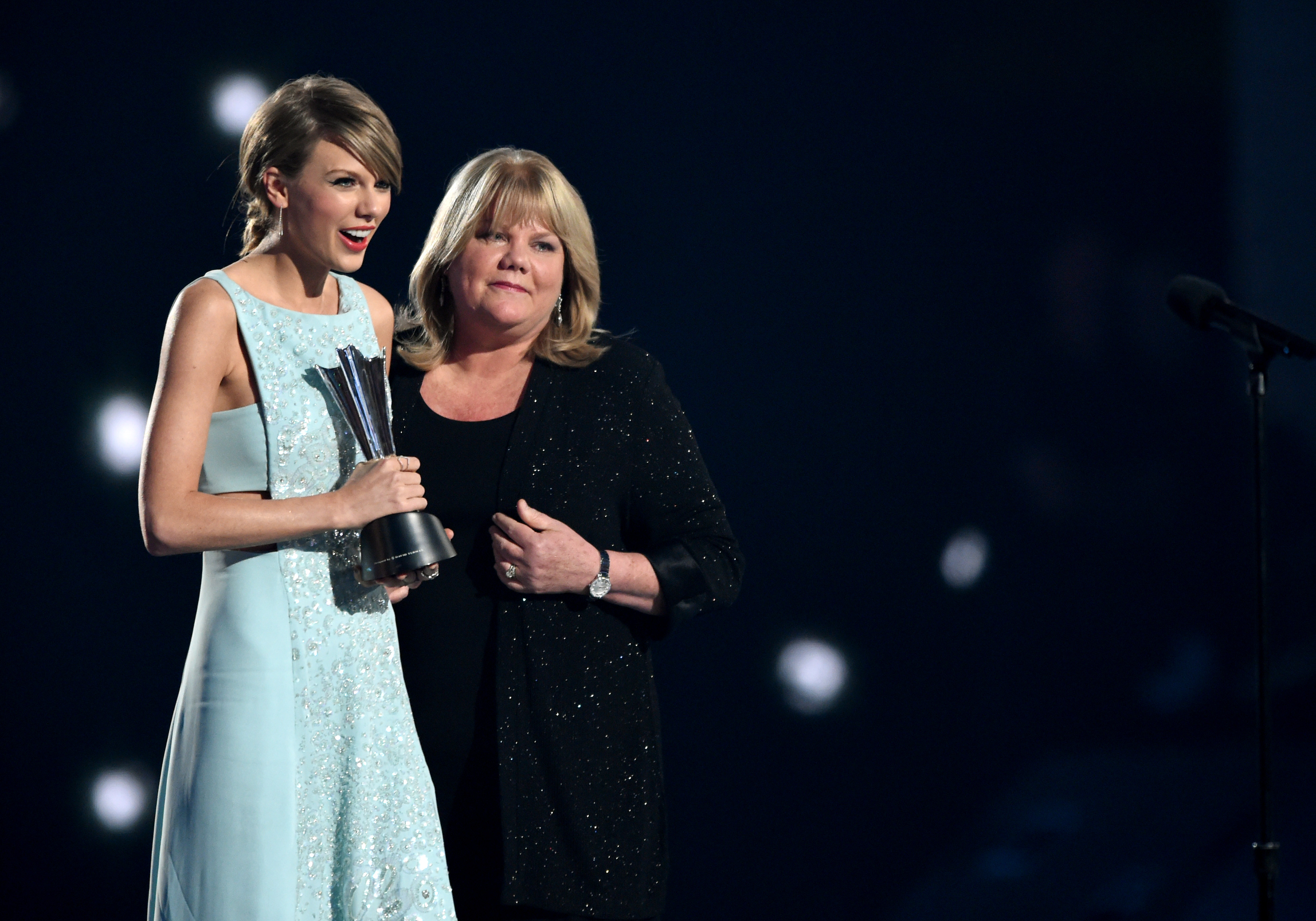 Honoree Taylor Swift accepts the Milestone Award from Andrea Swift onstage during the 50th Academy Of Country Music Awards at AT&T Stadium on April 19, 2015 in Arlington, Texas.