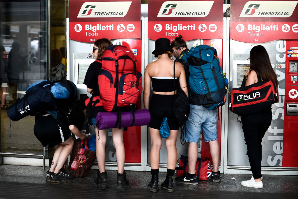 TORINO PORTA NUOVA RAILWAY STATION, TURIN, ITALY - 2019/07/22: A group of people use automatic machines to buy train tickets. On 22 July 2019 an arson fire in a rail transformer room near Florence caused long delays in high speed and regional trains. (Photo by Nicolò Campo/LightRocket via Getty Images)