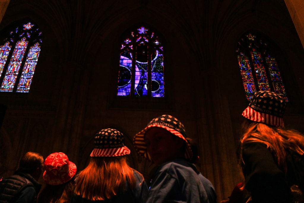 People observe the Washington National Cathedral's  Space Window  on June 11, 2019 in Washington, D.C.
