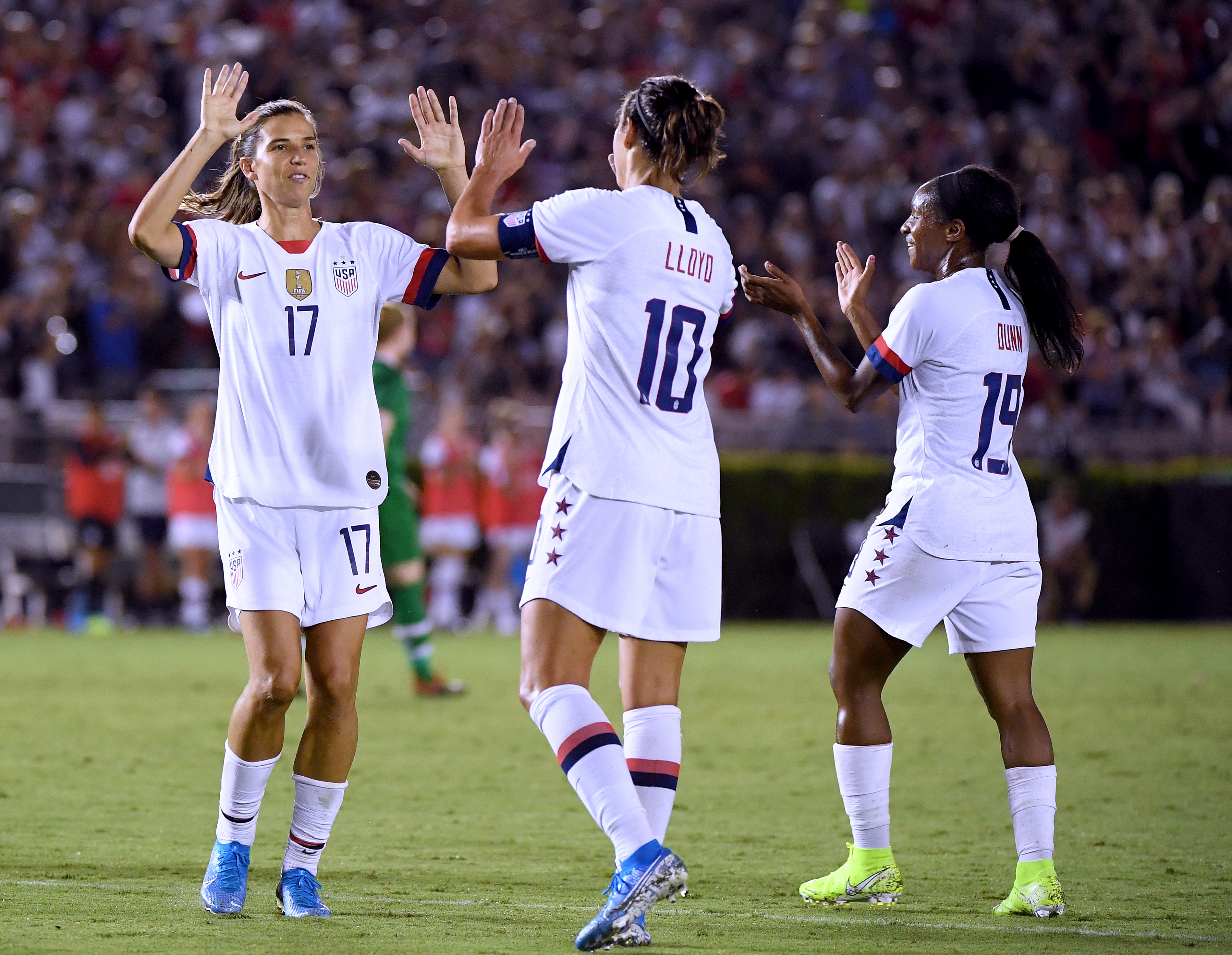 Carli Lloyd #10 of the United States celebrates her goal with Tobin Heath #17 and Crystal Dunn #19, to take a 3-0 lead over the Republic of Ireland, during the first half of the first game of the USWNT Victory Tour at Rose Bowl on August 03, 2019 in Pasadena, California.