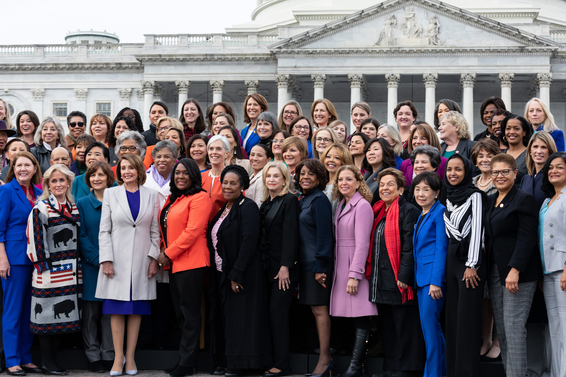 Speaker Nancy Pelosi (D-CA), (4th from left, front row), poses for a group photo with her fellow House Democratic women in front of the U.S. Capitol in Washington, DC, on  January 4. The 116th Congress currently has the largest number of female members.