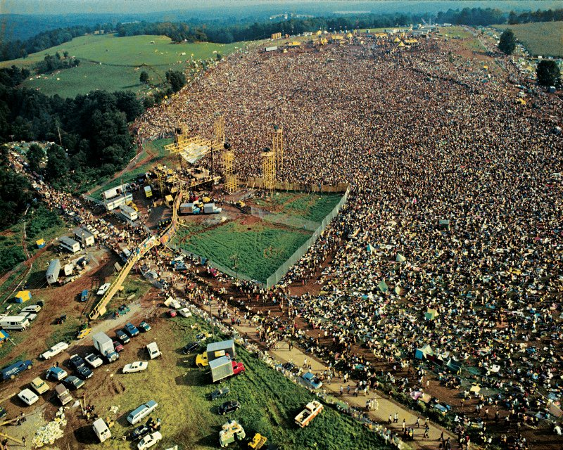 Aerial view taken from a helicopter of the stage and the five hundred thousand strong crowd gathered at the Woodstock Music and Arts Fair in Bethel, New York, August 15 - 17 1969.