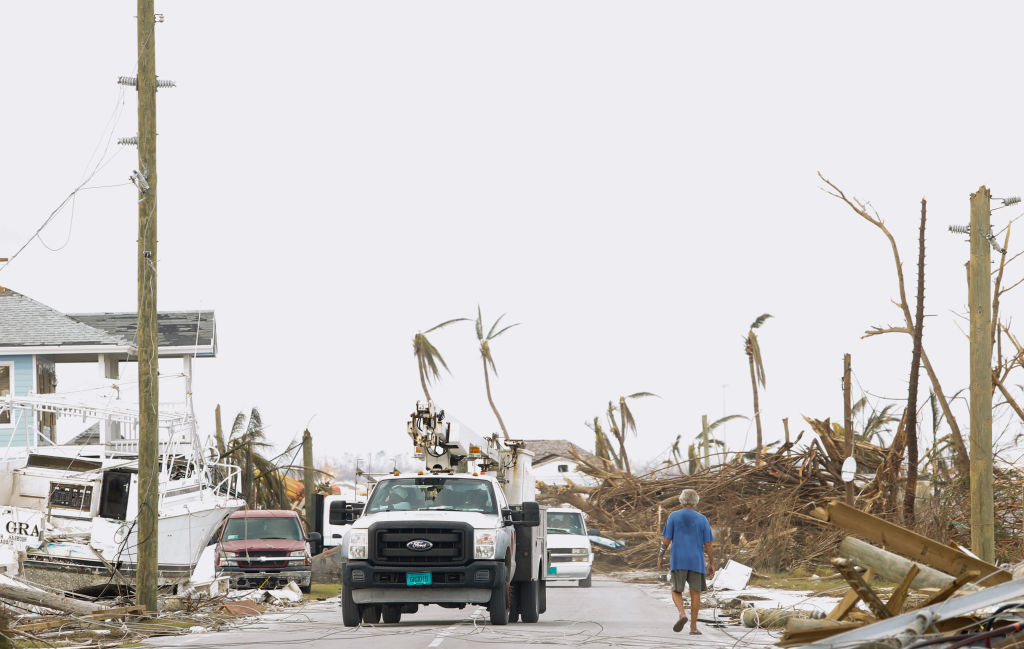 A power authority truck parks near downed wires on devastated Great Abaco Island on Sept. 6, 2019 in the Bahamas.