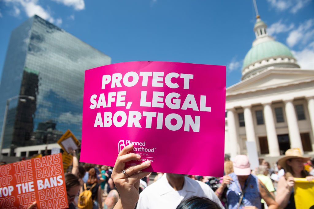 Protesters hold signs as they rally in support of Planned Parenthood and pro-choice and to protest a state decision that would effectively halt abortions by revoking the center's license to perform the procedure, near the Old Courthouse in St. Louis, Missouri, May 30, 2019.