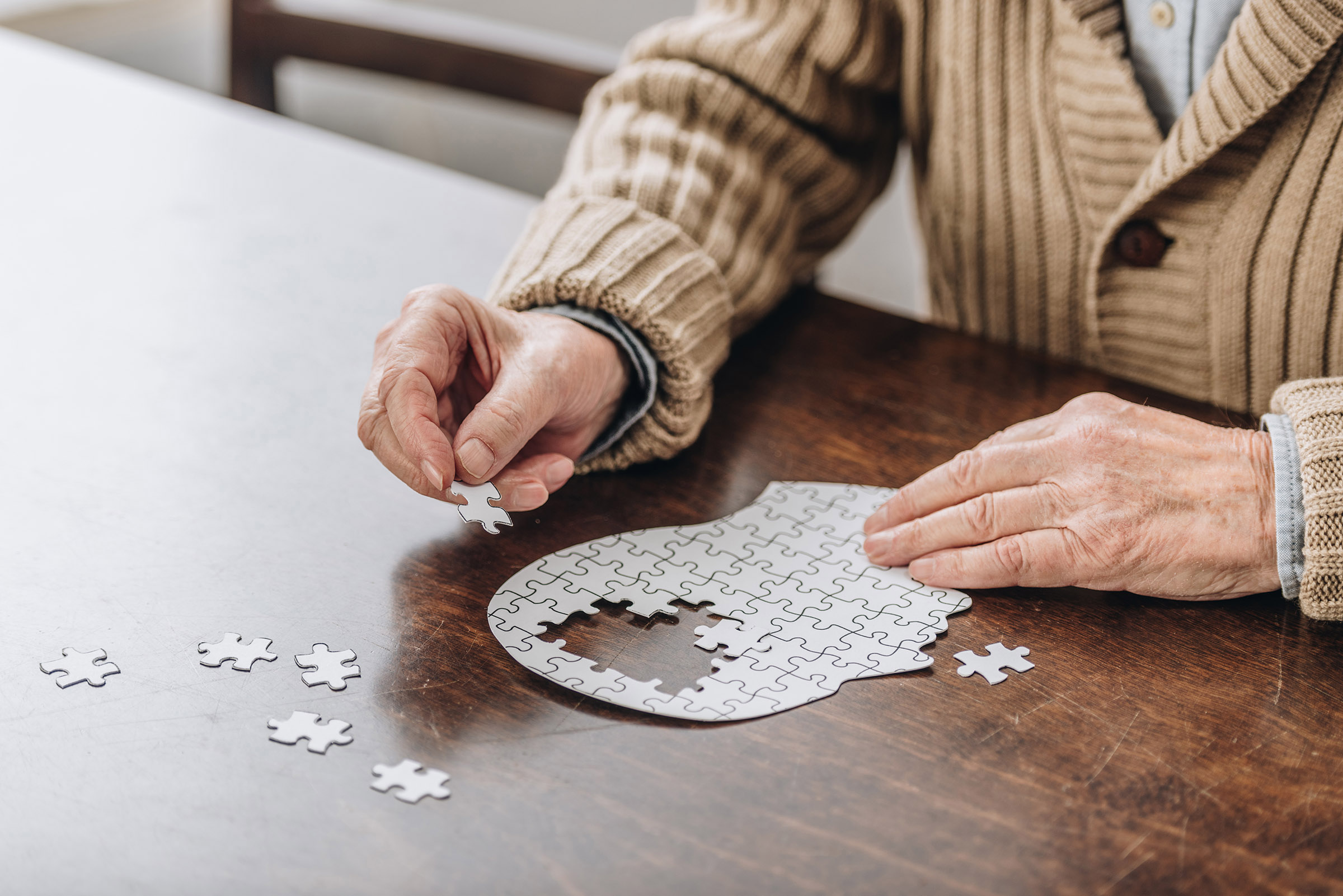 A senior playing with puzzles.
