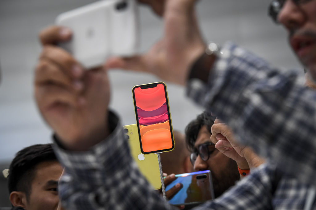 Attendees view the Apple Inc. iPhone 11 smartphone after an event in Cupertino, California, U.S., on Tuesday, Sept. 10, 2019.