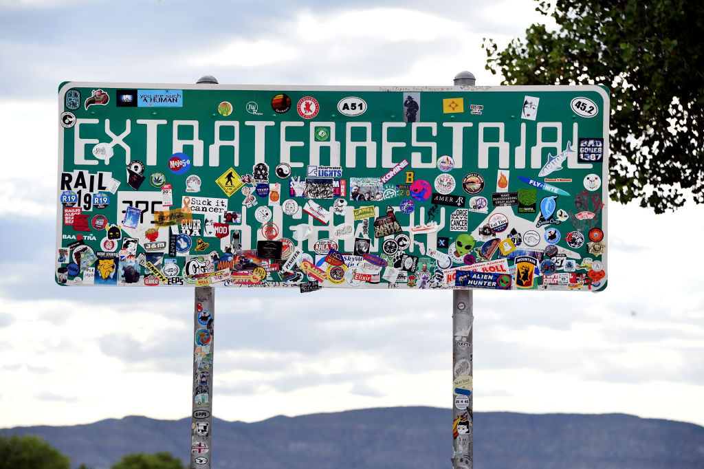 An Extraterrestrial Highway sign covered with stickers is seen along state route 375 on July 22, 2019 near Rachel, Nevada.